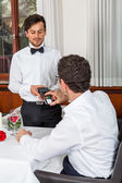 Waiter  accommodating man — Stock Photo