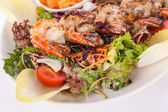 Grilled prawns with endive salad — Stock Photo
