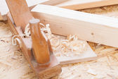 Handheld wood plane with wood shavings — Stock Photo
