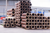 Plastic pipes in a factory — Stockfoto