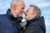 Elderly couple embracing — Stock Photo