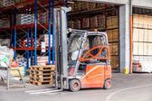 Forklift parked at a warehouse — Foto Stock