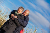 Elderly couple embracing — Stock Photo