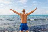 Man in blue swim shorts — Foto de Stock