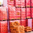 Red clay bricks stacked on pallets — Stock Photo #49583495