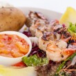 Grilled prawns with endive salad and jacket potato — Stock Photo #49583645
