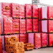 Red clay bricks stacked on pallets — Stock Photo #49584823