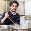 Chef stirring a huge pot of stew or casserole — Stock Photo #49585283