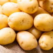 Fresh potatoes on sack — Stock Photo #49586153