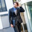 Businessman standing waiting for someone — Stock Photo #49586831