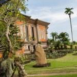 Ornate column in formal Balinese garden — Stock Photo #49587875
