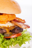Delicious egg and bacon cheeseburger — Stock Photo