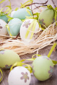 Colourful green Easter eggs in straw — Stockfoto