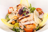 Tasty fresh caesar salad with grilled chicken and parmesan  — Stock Photo