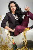 Seductive brunette holding a glass of champagne — Stock Photo
