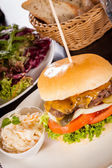 Cheeseburger with cole slaw  — Stock fotografie
