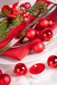 Red themed Christmas place setting — Stok fotoğraf