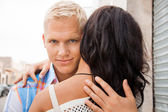 Romantic man hugging his girlfriend — Stock Photo
