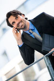Businessman listening to a call on his mobile — Stock Photo
