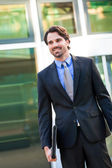 Businessman standing waiting for someone — Stock Photo
