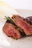 Succulent medium rare beef steak — Stok fotoğraf