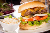 Cheeseburger with cole slaw  — Stock Photo