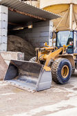 Parked pay loader near pile of dirt — Stock Photo