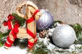 Christmas baubles on a tree — Stock fotografie