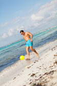 Mature man kicking ball — Stockfoto