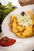 Crisp corn nachos with guacamole sauce — Photo