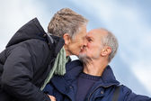 Elderly couple kissing — Stock Photo