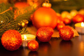 Warm gold and red Christmas candlelight background — Stok fotoğraf