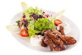 Grilled beef stripes fresh salad and goat cheese — Stock Photo