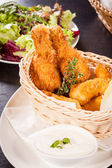 Crisp crunchy golden chicken legs and wings — Stock Photo