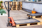 Small forklift parked at  warehouse — Stockfoto