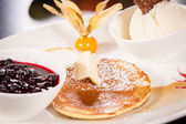 Tasty sweet pancakes with vanilla icecream and topping — Foto de Stock