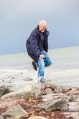 Mannen på stranden — Stockfoto