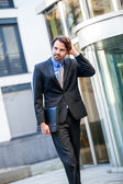 Businessman standing waiting for someone — Foto Stock