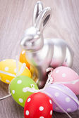 Easter still life with a silver bunny and eggs — Stock Photo