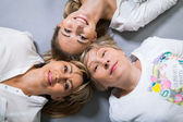 Attractive women lying on floor — Stock Photo