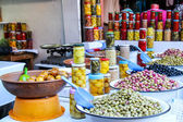 Olives and pickles on display at a farmers market — Стоковое фото