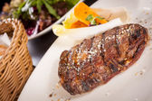Grilled beef steak with seasoning — Stock Photo
