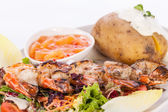 Grilled prawns with endive salad and jacket potato — 图库照片