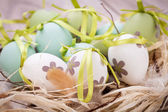 Colourful green Easter eggs in straw — Stok fotoğraf