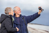 Elderly couple taking a self portrait — Stock Photo