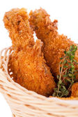 Crisp crunchy golden chicken legs and wings — Stock Photo