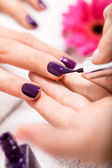 Woman having a nail manicure in a beauty salon — Stock Photo