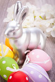 Easter still life with a silver bunny and eggs — 图库照片