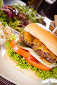 Cheeseburger with cole slaw  — Stockfoto