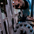 Blue pipes rusty old screws - Stock Photo